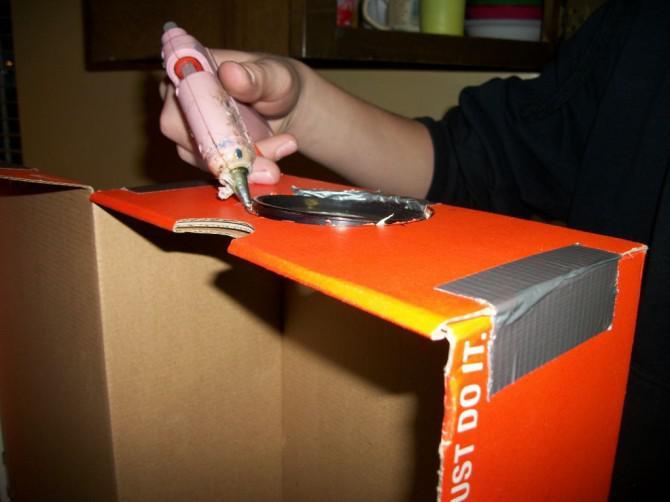 Wie man einen Projektor für Ihren iPod / iPhone für etwa $ 1 machen